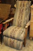 A Grieves & Thomas Bodyline beech reclining chair