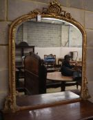 A Victorian gilt gesso overmantel, W.110cm, H.114cmCONDITION: There is an area of lost gesso to