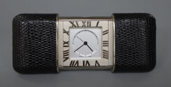 Tiffany & Co. A stainless steel and leather mounted purse alarm watch, Swiss quartz alarm
