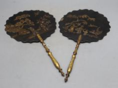A pair of Japanese lacquered face screens, length 42cm