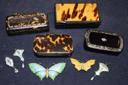Four 19th century papier mache snuff boxes, two enamelled silver butterfly brooches and three
