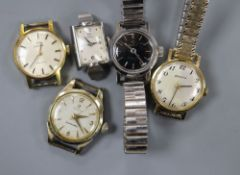 Four lady's Omega watches and a lady's Zenith watch.