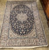 A Tabriz style blue and ivory ground rug, 270 x 176cm