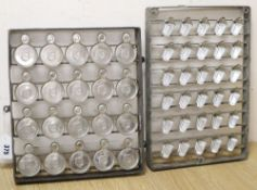 Two sets of Italian chocolate moulds, c.1950CONDITION: Circular moulds are 5cm diameterSmaller