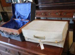 A lady's vellum dressing case and a gentleman's morocco dressing case, larger 50 x 34cm