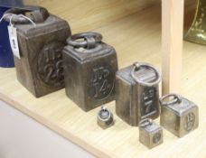A set of six cast iron weights, 4oz to 28lb