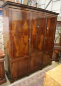 An Edwardian mahogany and boxwood line inlaid two door compactum wardrobe, W.194cm, D.61cm, H.215cm