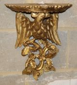 A George III style carved giltwood eagle and foliate design bracket, W.32cm, H.42cm