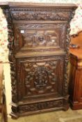A late 19th century Flemish carved oak fall front secretaire cabinet, W.106cm, H.162cm