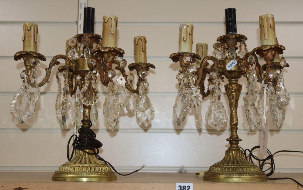 A pair of gilt four branch five light candelabra