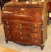 An early 19th century Dutch mahogany and chequer inlaid cylinder breakfront bureau, with fitted