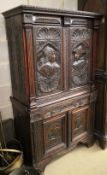 A late 19th century Flemish carved and varnished oak four door cupboard, fitted one drawer, W.