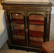 A 19th century ebony and boulle work two door glazed display cabinet, with ormolu mounts, W.105cm,
