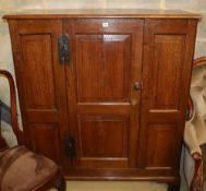 An 18th century and later oak cupboard with single panel central door, W.120cm, H.137cm
