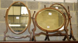 A mahogany skeleton framed toilet mirror with oval plate and two others