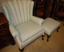 A Queen Anne I style wing armchair on shell carved cabriole forelegs, W.83cm, H.101cm and a matching