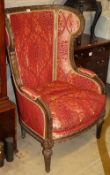 A late 19th century mahogany wing armchair with foliate and scroll carved frame, W.80cm, H.112cm