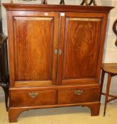 An early 19th century mahogany linen press, the top with a pair of fielded panelled doors over two