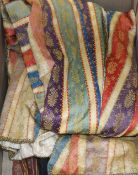 An early 20th century Indian stripe brocade full length coat, with cream silk damask lining and hand