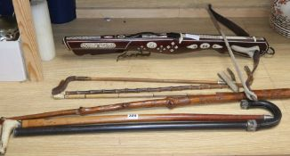A European bone inlaid crossbow, two walking canes and three riding crops