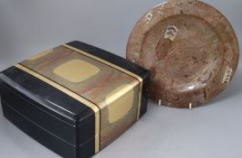 A 20th century Japanese lacquer picnic box and a Belemnite dish