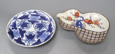 Two Japanese early Arita porcelain dishesCONDITION: The blue and white dish has light surface