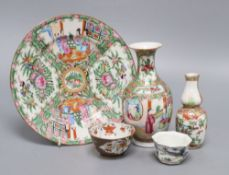Two Canton ware vases, a similar plate and two other pieces, largest plate diameter 21.5cmCONDITION: