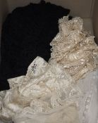 An Edwardian ladies lace blouse, a black bobbin lace shawl, a cream silk machine lace shawl and