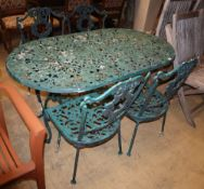 A painted metal garden table, W.136cm, D.76cm, H.68cm, bench seat and two chairs