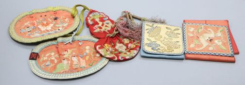A collection of five Chinese embroidered purses, a red silk applique worked purse with silk tassels,