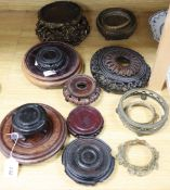 A collection of Chinese bronze and wood stands, etc.