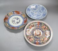 Two Japanese Arita dishes and a Chinese blue and white dish, largest diameter 24cmCONDITION: The