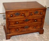 A Georgian style miniature feather banded walnut chest of drawers, W.39cm, D.21cm, H.30cm