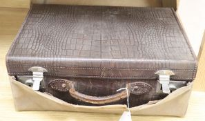 A faux crocodile suitcase and cover, width 45cm depth 30cm height 18cm