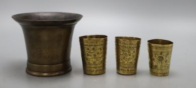 A 19th century bronze mortar and three small Persian measures