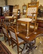 An 18th century design oak draw leaf dining table, 260cm extended, W.91cm, H.79cm and six chairs (