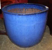A large blue glazed garden planter, 55cm diameter, H.46cm