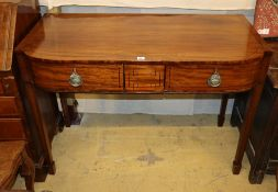A Regency and later mahogany and ebony line inlaid three drawer bow fronted serving table, W.