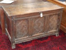 A 17th/18th century carved and panelled oak coffer, W.120cm