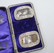 A pair of 19th century cut steel buckles, cased