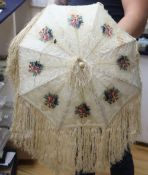 A Victorian embossed velvet and cream silk ladies parasol, with coloured floral cartouches, silk