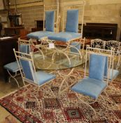 An enamelled metal dining suite comprising a circular glass-topped table and a set of eight