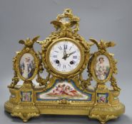 A French gilt bronze and Sevres-style porcelain mounted mantel clock.