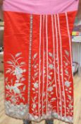 A Chinese embroidered panel and a similar wedding skirtCONDITION: The red embroidered Chinese