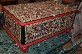 An Indonesian carved painted hardwood coffer, W.99cm, D.59cm, H.45cm