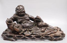 A Chinese hardwood carving of Liu Hai, width 43cm