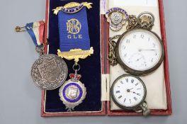 Two silver pocket watches, a silver buffalo medallion, coronation medal etc.