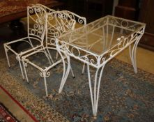 A glass top painted wrought iron garden table, W.91cm, D.50cm, H.74cm together with four chairs (