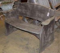 A rustic wood garden bench, W.120cm, D.43cm, H.74cm