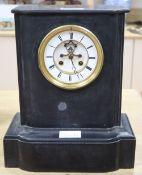 A Victorian black slate mantel clock
